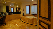 master bath is quite large with marble floors, double sinks, make-up area, jacuzzi tub, large, walk-in shower